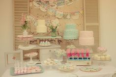 """LOVE THE PROPS>  It wouldn't be a Jenny Cookies party without one of her signature dessert tables. """"We did three textured buttercream cakes, magic wand cake pops, pink marshmallow pops, cupcake bites, mini cupcakes topped with baby-blue chocolate hearts, and sugar cookies in the shapes of glass slippers, carriages, crowns, wands, and hearts,"""" Jenny said. Various cake plates and a vintage tile backdrop gave an old-fashioned feel to the table."""