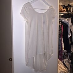 AMERICAN EAGLE OFF WHITE BLOUSE Off white back chiffon shirt. Back has a V shape ... NO TRADES American Eagle Outfitters Tops Blouses