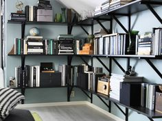 Free your floor and other surfaces from disorganization with EKBY HEMNES shelves that put your walls to work.