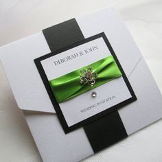 Pocketfold wedding invitation featuring gorgeous lime green satin ribbon and antique style floral brooch centre with black mount and belly band wrap.  www.rednell.com