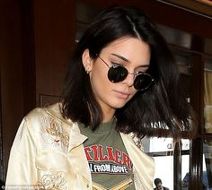 Chopped: Kendall Jenner shocked her fans when she cut long hair into a trendy lob last week. The model is pictured showing off her hair while having lunch atIl Pastaio in Beverly Hills on Monday