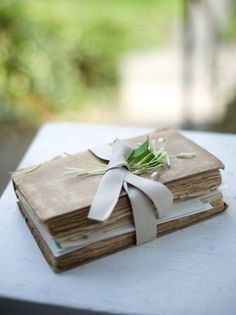 "I'd like to have a wedding journal that all the guests write a little ""tip of advice"" or a small memory they shared with the couple, or how they met, etc. They could even leave pictures, flowers, or other small special items that could be put in the journal."