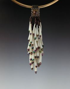 Another by Kay Bonitz.  Apparently the white beads are Dentalium shells.