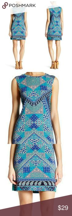New Item   Blue Patchwork Knit Tank Dress New Arrival  Patchwork Knit Tank dress. crew neck, sleeveless, all over print in shades of blue and  turquoise. approx. 33\