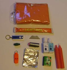 finalized survival kit before packed:  Fishing line  Whistle  Chemical light stick  Emergency Candles (optional)  Small LED keychain flashlight  Tinfoil  Piece of paper  Duct tape  Bic pen  Razor blade  Box of WATERPROOF matches  Water treatment (for example iodine or chlorine. I use drops i bought at Coast Mountain Sports)  Poncho, OR a space blanket. (I used a Poncho because it doesnt rip as easily, although this sacrifices space.)