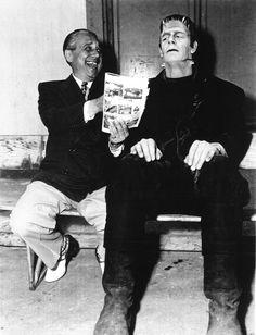 """Glenn Strange enjoys being read some comics on the set of """"House of Frankenstein""""."""