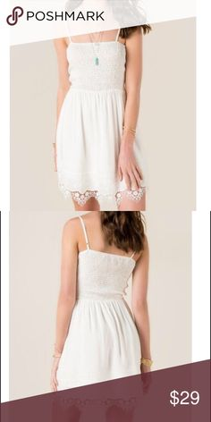 Beautiful White Dress Beautiful white Dress with lace hem, adjustable straps and stretch bodice. rayon with Cotton contrast. Alya Dresses