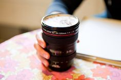 The camera lens mug from photojojo. $24