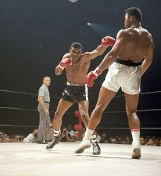 Floyd Patterson throws a punch at Muhammad Ali during their 1965 fight at Las Vegas Convention Center. Ali would go onto win by a TKO in the round. (Neil Leifer/SI) GALLERY: Never-Seen Photos of Muhammad Ali Mohamed Ali, Floyd Patterson, Muhammad Ali Boxing, Boxing History, World Heavyweight Championship, Boxing Champions, Ali Quotes, Mike Tyson, Sports Memes