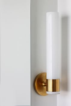 KOHLER purist wall sconce has a nice glow for getting ready and a night light feature -- check it out at this site: http://www.huntedinterior.com/2014/11/black-white-bathroom-makeover.html#_a5y_p=2820381