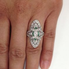 An elegant vintage diamond and emerald dinner ring circa 1920. Please, sir, can I have some more? Exclusively at Single Stone. (213) 892-0772 www.singlestone.com @singlestonemissionstreet #deco #artdeco #emerald #diamond #vintage #finejewelry #platinum #dinnerring #rings #wow #grand #elegant #gorgeous #statement #statementring #righthandring #engagement