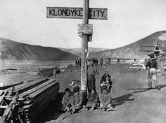Children of the Klondike area of Yukon Territory, Canada, sitting with their dog by a street sign, 1890 Mans Best Friend, Best Friends, Happy National Dog Day, Prince, St Bernard Dogs, Call Of The Wild, Guide Dog, Vintage Dog, Foto Vintage