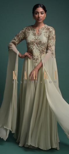 Buy Online from the link below. We ship worldwide (Free Shipping over US$100)  Click Anywhere to Tag Dusty Green Indowestern Gown In Georgette With Extended Floor Length Sleeves Online - Kalki Fashion Dusty green indowestern gown in georgette with extended floor length sleeves.Adorned with zari and zardozi embroidered floral pattern on the bodice.Constructed with round neckline with keyhole and sheer embellished back with zip
