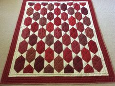 Big stitched quilt made by Sharon Theriault.  Pattern is Lozenges