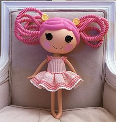 I need to make some of these!!! lalaloopsy clothing!!! lily would be SOOO happy if i made some of these! y on earth didnt i think of that?! (pattern is crochet but could do this with knitting easily.)