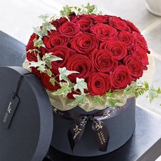 This elegant arrangement of premium roses makes a truly luxurious gift. The Grand Prix roses are a stunning large-headed variety with sumptuous, velvet petals in an eye-catching shade of deep scarlet. Decorated with ivy and presented in a stylish hatbox, this is a chic choice.