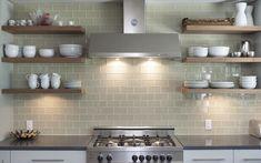 Bertazzoni range & hood; Ann Sacks glass tile, walnut open shelves, concrete countertop; French Place Cottage by Rick & Cindy Black Architects