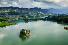 Ile d'Ogoz sur le lac de la Gruyère by Yann Arthus-Bertrand