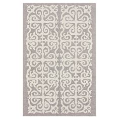 Bring polished elegance to your decor with this lovely wool rug, showcasing a scrolling medallion motif for a touch of visual interest.