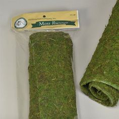"48"" Long Moss Mat Table Runner, 14"" Wide. A unique and beautiful way to bring the outdoors to any event! A beautiful centerpiece in itself, great with added touches of flowers for a forest-bed look. B"