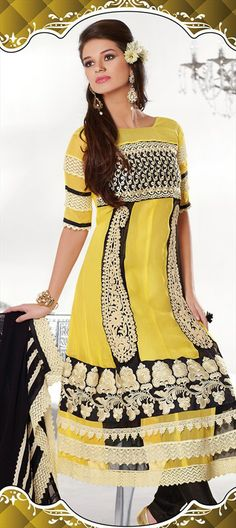 94242: Yellow color family unstitched Salwar Kameez.