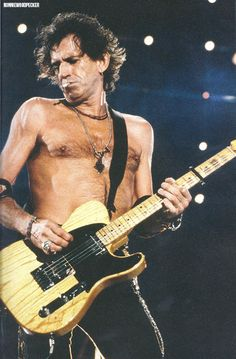 Keith Richards on stage during the Voodoo Lounge Tour, photo by Tony Mott.