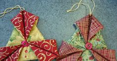 To make one of these fabric ornaments, you will need: - two contrasting Christmas fabrics - two buttons or charms - thread/ribbon for hangi...