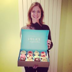 shows the cupcakes she received as a thank you from our clients wendy