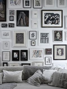 Black and white art wall in a lounge or living room #artwall #monochrome #interior