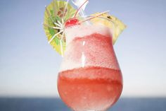 The rock lobster is a fun frozen cocktail that's filled with tropical fruit flavors. The easy rum recipe features a delicious blend of coconut and banana. Tropical Drink Recipes, Frozen Drink Recipes, Rum Recipes, Cocktail Recipes, Margarita Recipes, Alcohol Recipes, Coconut Mojito, Malibu Coconut, Coconut Rum