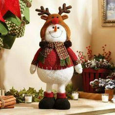 This charming plush snowman will melt your heart! Dressed in a red sweater and cozy reindeer hat, this snowman statue is a frosty addition to your holiday home. Handmade Christmas Decorations, Xmas Decorations, Holiday Decor, Family Holiday, Christmas Snowman, Christmas Crafts, Christmas Ornaments, Christmas Christmas, Christmas Stockings