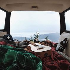 Adventure is out there: camp in the mountains with cozy blankets and a beautiful view