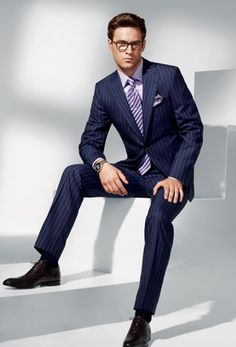 "The pinstripe suit has evolved from the uptight ""banker"" connotation; to the suit you wear when you want to exert a little more influence at the office. Better known as the ""power suit"", the pinstripe is no longer for ""office use only"". For an elegant look, wear it with a contrast collar, French cuffs and cuff links. If you prefer a more modern take, try wearing a spread collar with thickly knotted tie. By wearing a tie that plays off of the stripe, you create a more cohesive sophisticated look."
