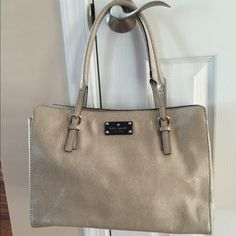 Kate Spade Beige Kelsey Tote -Textured patent leather with resin designer logo plate at front -Four feet at base -Two adjustable top handles -Magnetic snap closure -Signature printed interior lining with two slip pockets and a zip pocket.  Body length 14 inches; height 10 inches; width 5¼ inches  -Drop handle 6½ inches Brand new. Perfect condition. No marks or damage anywhere on the bag. Comes with dust bag. kate spade Bags Totes
