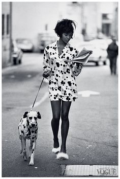 Naomi Campbell for Vogue June 1990, photographed by Peter Lindbergh. Dalmatian theme, white flats, newspaper