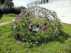 Bicycle rims, cable ties, creeping plants and a little hard work= a really fun play hut!