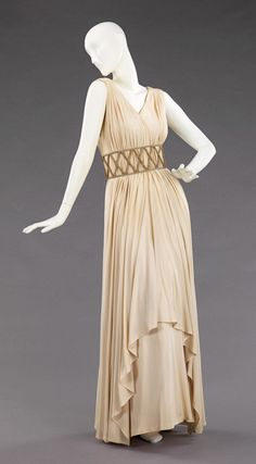 """""""Falernum"""" Evening Dress, Elizabeth Hawes (American, 1903–1971): 1948, American, silk, metal. """"...Hawes draped fabrics on the body and creatively pieced together wearable garments that were also beautiful works of art. Hawes' philosophy toward fashion also shaped her aesthetic. She firmly believed there was a difference between fashion and style. Style, she declared, 'is dressing to fit your own self – it lasts.'..."""""""