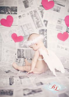 Baby Valentine Photos, pictures, girl, Cupid set up lots of newspapers add some heart cut outs and whala!