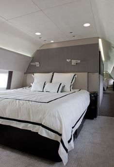 Nice Private Jet Interior Photos With Modern Master Bed With White Covered Bed Also White Pillows And Grey Carpet And White Ceilings Modern Furnitures Inspiring Design