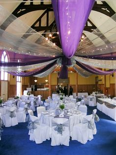 Tammy and Westley - October 2014 - Royal Purple and Siver canopy with fairylights, purple runners with crushed silver overlays, silver organza sashes and white and Aubergine Calla Lillies