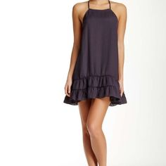 "NWT Free People Sensual Dress Halter Front and racerback ruffle dress. Has tiered Ruffles hem, drop waste and is approximately 33"" long. Color is Charcoal Free People Dresses Strapless"
