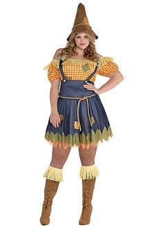 This sexy, plus-size scarecrow costume for women features a minidress with an attached denim-print jumper, faux straw trim, and a layered skirt with jagged hem and patches.