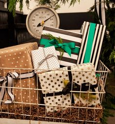 14 Quick & Stylish Party-Throwing Tips...presents stacked in a vintage scale.