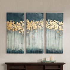 Midnight Forest by Madison Park is a diptych set will add style and sophistication to your living room. The set incorporates a beautiful teal color and hand applied gold foiling for added dimension. O
