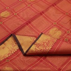 Gold checks, stripes and peacock motifs give this arakku red #silk #sari a diffused and luminous appearance, every intersection dotted with a hint of henna green. The unusual gold border boasts of floral swirls and the pallu is a symphony of traditional leaf, peacocks and sun motifs in resplendent zari. View this regal collection at Sarangi. Code 020124341.