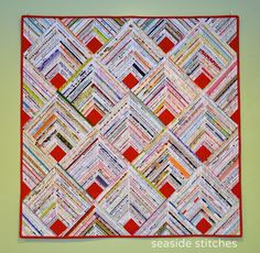 Tina Craig of Seaside Stitches in Rhode Island just finished her second selvage quilt, and it& a real beauty! It was inspired by my. Scrappy Quilts, Mini Quilts, Bed Quilts, Quilting Projects, Quilting Designs, Quilting Ideas, Log Cabin Quilts, Log Cabins, Quilt Modernen