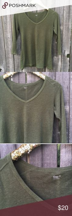 """GAP Olive Green V-Neck 3/4 Sleeves Tee M Good Used Condition. Some pilling, but absolutely no stains, damage or holes. Gorgeous hunter or olive green--so on trend! Relaxed, flowy and flattering fit. Perfect length. 17"""" pit to pit. 25"""" shoulder to hem length. Offers warmly welcomed! GAP Tops Tees - Long Sleeve"""