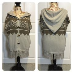 Vasia Sweater from Urban Outfitters Very soft comfortable sleeveless sweater with pockets and a hoodie!  Cool toggle front, fun pattern with fringe. Urban Outfitters Sweaters