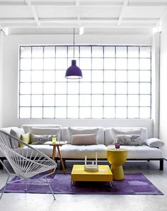 Subtle accents of yellow keep this space vibrant. Home decor, interior design, yellow, living rooms