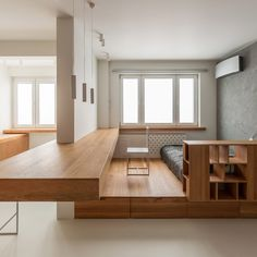 Space-saving oak furniture and white-washed walls feature in this minimalist studio apartment renovation by Ruetemple Studio in Moscow, Russia. Apartment Renovation, Apartment Design, Micro Apartment, Apartment Ideas, Built In Furniture, Furniture Design, Small Apartments, Small Spaces, Home Interior Design